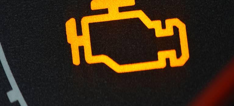 Тревожный символ наприборной панели