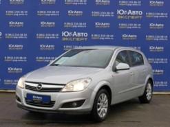 Opel Astra 2013 г. (серебряный)